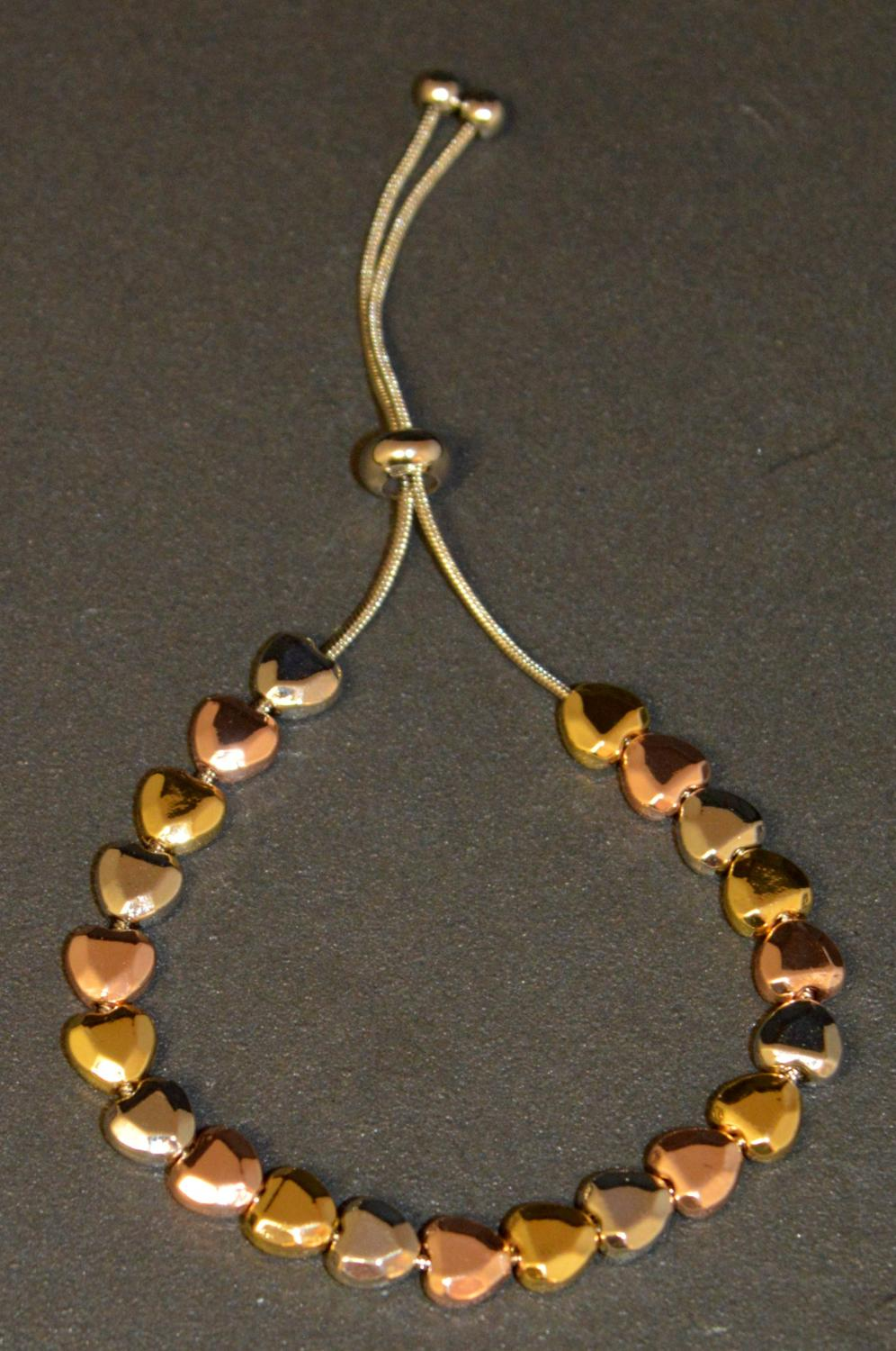 Mini Hammered Effect Heart Metal Beads on a Adjustable Bracelet